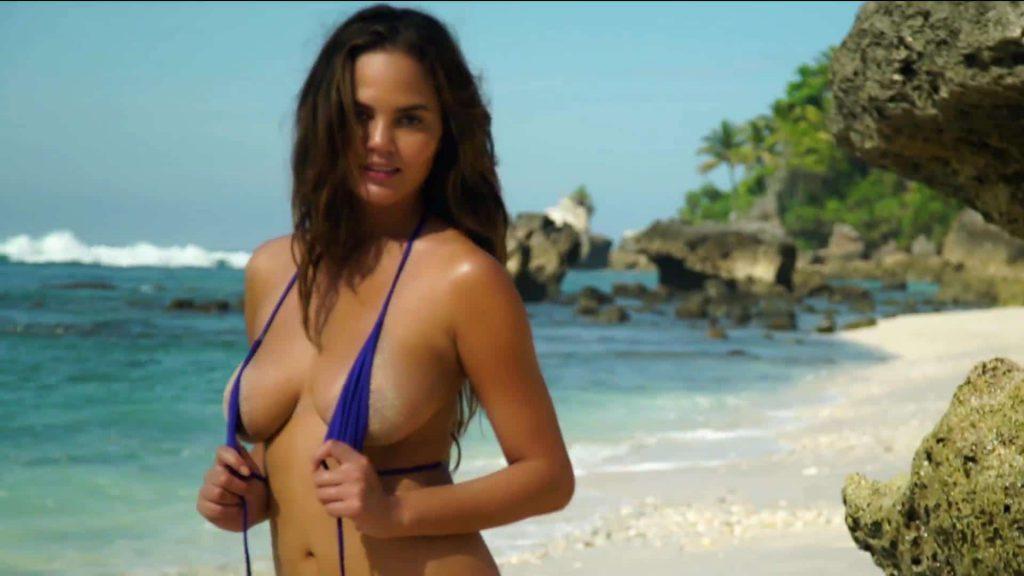 Chrissy Teigen beach pose