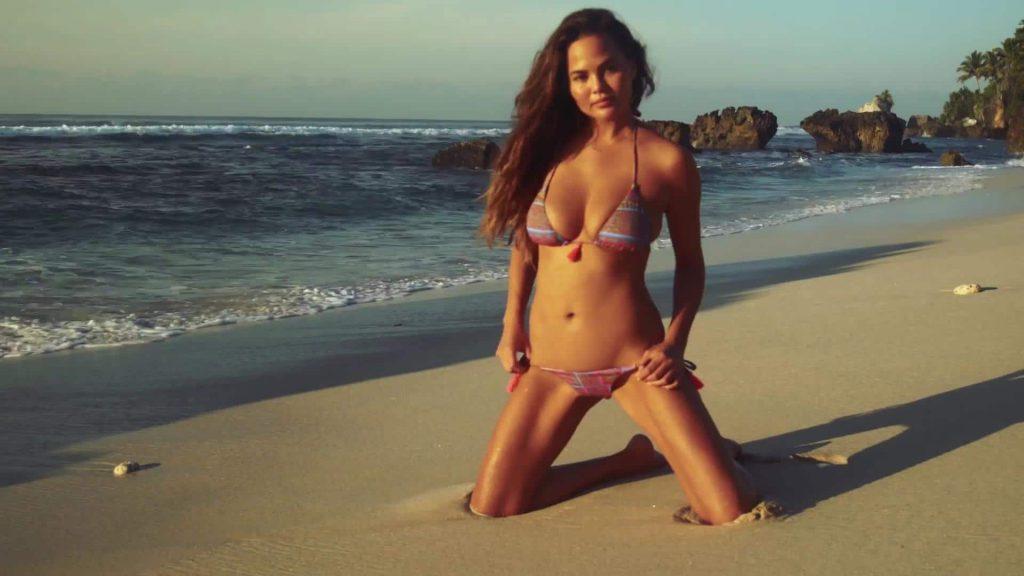 Chrissy Teigen nude beach pose